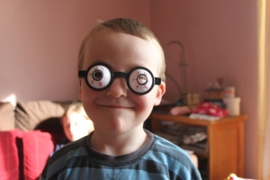 Ruairí modelling his funny glasses