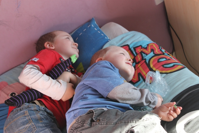 Ruairí and Benjamin curled up.