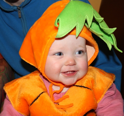 Evelyn dressed as our traditional pumpkin