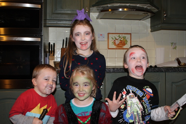 Benjamin, Elizabeth, Ruairí and Caoimhe at the back with their faces painted